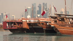 Wooden dhow vessels and Doha skyline Stock Footage