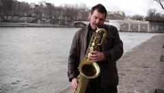 Sax musician Seine River, Paris - 1080p - stock footage