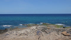 Rocky beach and blue waters of the Mediterranean sea Stock Footage