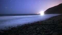 Stock Video Footage of Astrophotography Time Lapse of Moonlit Coastline in Malibu Beach -Tilt Up-
