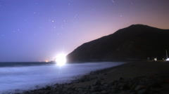 Stock Video Footage of Astrophotography Time Lapse of Moonlit Coastline in Malibu Beach -Pan L-