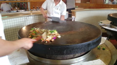 Big wok mongolian bbq with large pan, meat and vegetables Stock Footage