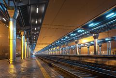 Railway station at night. Train platform in fog. Railroad Kuvituskuvat