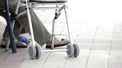 Walker or stroller to walk to old or older person Stock Footage