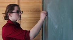 Stock Video Footage of the teacher wrote on the blackboard in the school mathematical equation