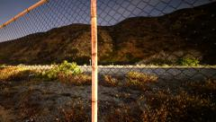 4K Motion Control Dolly Time Lapse of Night Highway through Fence Stock Footage