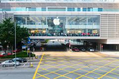 Crowd of people crossing in front of an Apple store, Hong Kong, China. Stock Photos