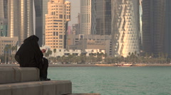 A veiled woman using her smartphone in Doha, Qatar - stock footage