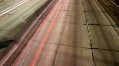 Time Lapse of Light Trails on 110 Freeway in Downtown LA at Night -Tilt Up- Stock Footage