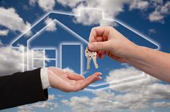 Handing Over the House Keys on Ghosted Home Icon, Clouds and Sky. - stock photo