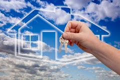 Man Handing Over the House Keys on Ghosted Home Icon, Clouds and Sky. - stock photo