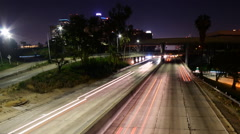 Time Lapse of Light Trails on 110 Freeway in Downtown LA at Night -Long Shot 1- - stock footage