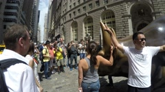 Tourists taking photo of the Charging Bull, Manhattan Stock Footage