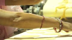 Indian flat bread puri. machine cutting Stock Footage
