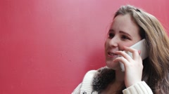 Close up of a young woman chatting on the mobile with copy space Stock Footage