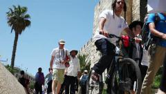 Jerusalem. People walk along the old city walls. Stock Footage