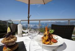 exclusive lunch near the sea - stock photo
