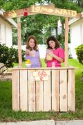 Young girls selling lemonade - stock photo