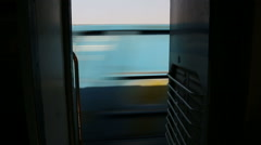 Stock Video Footage of View on parallel passing train from train door during ride.