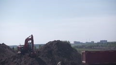 Excavator on a construction site Stock Footage
