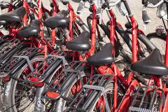 red rental bicycles in amsterdam - stock photo