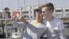 Cute Gay Couple Take Selfies Together, Then Look Out At Boats(4K) Stock Footage