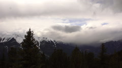 Time-lapse atop Sulphur mountain in Banff, Alberta of clouds churning over the t Stock Footage