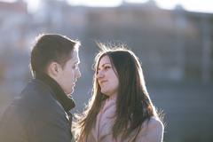 Young couple dating in the city park - stock photo