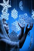 Young woman in glistering make up holding paper snowflake Stock Photos