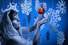 Young woman in glistering make up holding red Christmas decoration ball Stock Photos