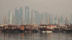 Qatar, traditional dhow boats and modern Doha skyline create contrast Stock Footage