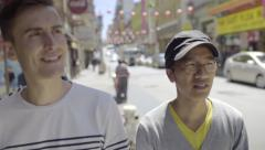 Stock Video Footage of Gay Couple Explore Chinatown, San Francisco, They See Something Funny And Laugh