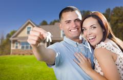 Military Couple with House Keys In Front of New Home Stock Photos