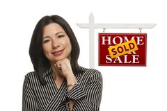 Woman and Sold Home For Sale Real Estate Sign Isolated - stock photo
