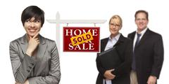 Mixed Race People with Sold Real Estate Sign Isolated - stock photo