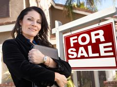 Female Hispanic Real Estate Agent, For Sale Real Esate Sign and House Stock Photos