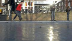 Ice skating in historical Amsterdam Stock Footage