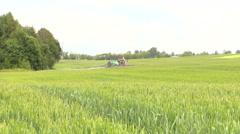 farmer spray crop field at summer season, herbicides, pesticides - stock footage