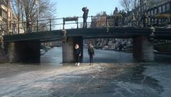 Ice skating under bridge in Amsterdam Stock Footage