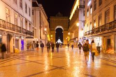 Augusta street by night near commerce square in Lisbon , Portugal Stock Photos