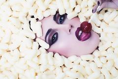 Tempting girl in corn sticks heap Stock Photos