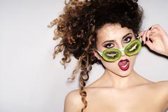 Fashionable young alluring girl in fruit glasses - stock photo