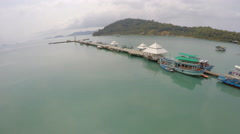 Aerial dock with boats Thailand Stock Footage