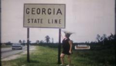 2113 - Georgia State Line roadside highway marker - vintage film home movie Stock Footage