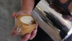 Learning step of barista making a cup of art latte, shape of a heart Stock Footage