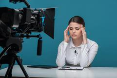 Beautiful girl tv newscaster is very tired - stock photo