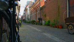 Bicycle in  Korte Annastraat Haarlem Holland Netherlands Stock Footage