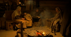 A peasant family around the fireplace - stock footage