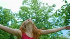 Beautiful young girl enjoying life Stock Footage