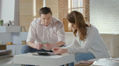 Couple calculating income and expenses, low family budget, money Stock Footage